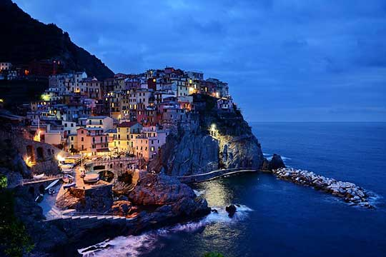 Italian houses on cliff at ocean | 4 destinations off the radar